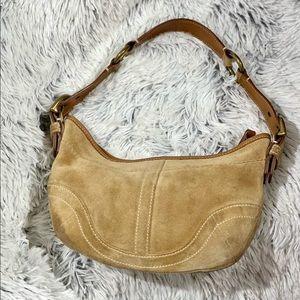 COACH-Tan suede shoulder zip top bag.